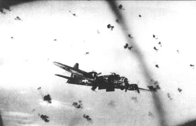 B 17 'Flying Fortress' of the United States Air Corps attacked by Flak over 'Flak-Alley'